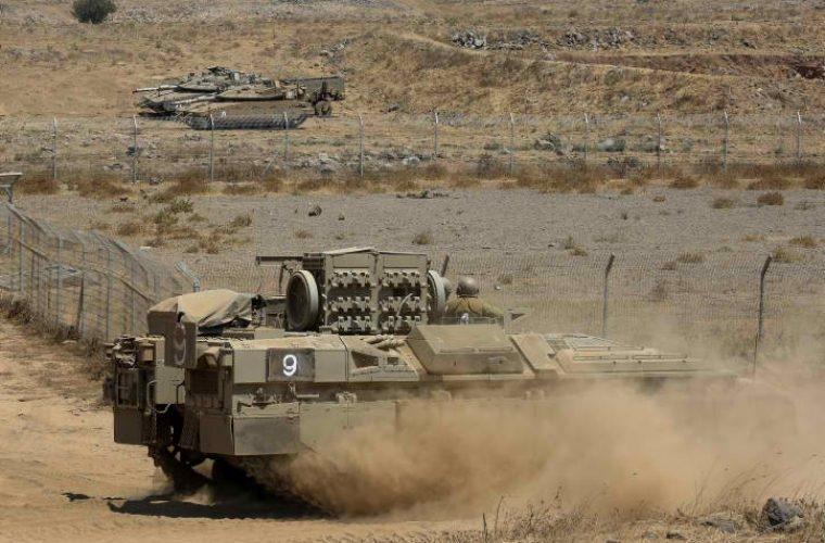 חיילים ישראלים נראו במהלך התרגיל בסמוך לגבול ישראל-סוריה, ברמת הגולן, צפו צילום: דוד כהן / Flash90